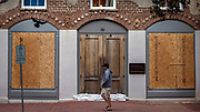 A pedestrian walks the nearly empty streets of historic downtown Savannah, Ga., Sunday, Sept., 10, 2017 before Hurricane Irma is forecast to impact the area. Once in the forecasted path of the storm, Savannah, can much of coastal Georgia, evacuated late last week.  (AP Photo/Stephen B. Morton)