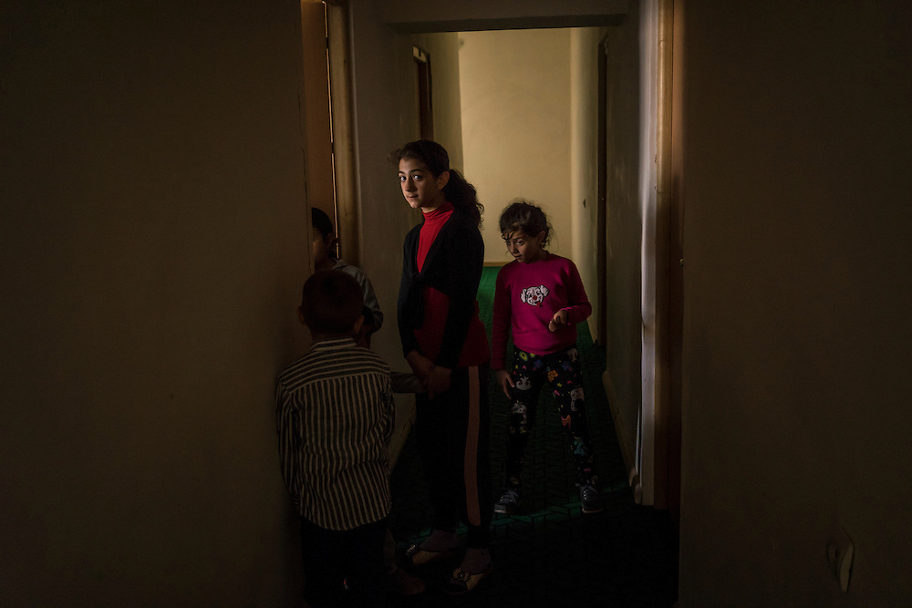 Children who were displaced along with their families by recent fighting in the city of Martakert stand in the hallway of a hotel where they are temporarily being housed on Monday, May 9, 2016 in Stepanakert, Nagorno-Karabakh.