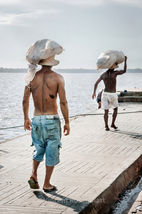 """Workers in the Ver-o-Peso fair district, in Belem - the capital of the state of Para, Amazonia . Main touristic attraction of Belem, memory of the spendor of the city """" door of Amazonia"""", when rubber was the main good and wealth of the region. Guajara bay.."""