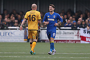 AFC Wimbledon midfielder Jake Reeves (8) shares a joke with Sutton United Nicky Bailey (16) during The FA Cup match between Sutton United and AFC Wimbledon at Gander Green Lane, Sutton, United Kingdom on 7 January 2017. Photo by Stuart Butcher.