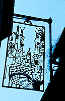 Detail of an ornamental wrought iron sign  hanging on a building in Venice, Italy.