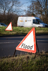 © Licensed to London News Pictures. 02/01/2014. River Blackwater, Hampshire, UK. Floods signs along theA36 near Romsey in Hampshire, UK. The road was closed overnight due to the northbound carriage being flooded by the River Blackwater. River levels are high following a night of wet and windy weather. More wet and windy weather is forecast. Photo credit : Rob Arnold/LNP
