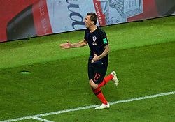 MOSCOW, RUSSIA - Wednesday, July 11, 2018: Croatia's Mario Mandžukić celebrates scoring the second goal past England's goalkeeper Jordan Pickford in the second half of extra-time to make the score 2-1 to Croatia during the FIFA World Cup Russia 2018 Semi-Final match between Croatia and England at the Luzhniki Stadium. (Pic by David Rawcliffe/Propaganda)