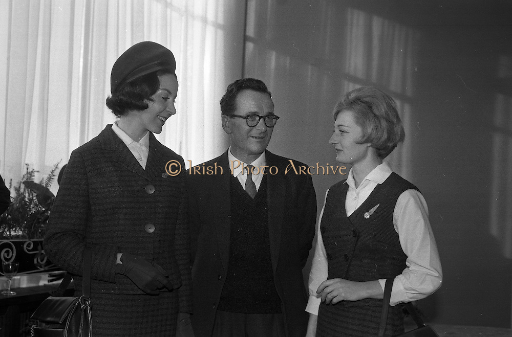 A group of Aer Lingus hostesses model their new uniform of Irish tweed. The three-piece ensemble in St Patrick's blue is worn with a sculpted beret and accessories in midnight blue. The material was designed and made by the McNutt Weaving Co., Downings, Co Donegal..13.12.1962