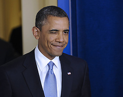 U.S. President Barack Obama winks as he arrives in the briefing room at the White House in Washington DC, the United States, January 1, 2013. Photo by Imago / i-Images...UK ONLY