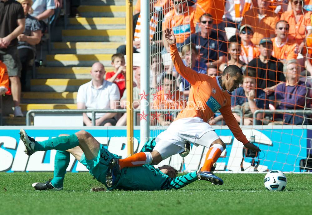 BLACKPOOL, ENGLAND - Sunday, April 10, 2011: Arsenal's goalkeeper Jens Lehman gets a hand on the ball under pressure from Blackpool's Dudley Campbell during the Premiership match at Bloomfield Road. (Photo by David Rawcliffe/Propaganda)
