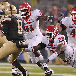 Oct 23, 2009; West Point, N.Y., USA; Rutgers defensive tackle Justin Francis (91), cornerback Zaire Kitchen (29) and linebacker Ryan D'Imperio (44) pressure Army quarterback Trent Steelman (8) during Rutgers' 27 - 10 victory over Army at Michie Stadium.