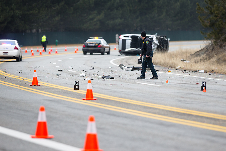GABE GREEN/Press<br /> <br /> An officer with the Kootenai County Sheriff&rsquo;s Department looks at the wreckage of one of the vehicle&rsquo;s involved in a major collision Tuesday morning on Coeur d&rsquo;Alene Lake Drive.