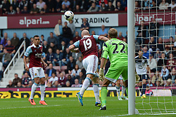 West Ham United's Jussi Jaaskelainen watches on as West Ham United's James Collins heads the ball clear  - Photo mandatory by-line: Mitch Gunn/JMP - Tel: Mobile: 07966 386802 21/09/2013 - SPORT - FOOTBALL - Boleyn Ground - London - West Ham United V Everton - Barclays Premier League
