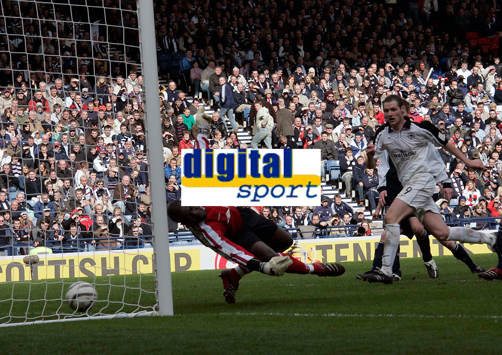 Photo: Tom Ross.<br />Gretna v Dundee. Tennants Scottish Cup, Semi-Final. 01/04/2006.<br />Kenny Duchar looks on as the ball passes Kelvin Jack to take Gretna to 3-0. The goal was an own goal by Dundee captain Barry Smith.