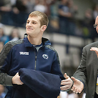 February 23, 2014; State College, PA, USA; Penn State athletic director David Joyner applauds David Taylor after he was introduced to a sell-out crowd at Rec Hall during senior recognition before the Nittany Lions match against the Clarion Eagles. Penn State defeated Clarion 43-3.