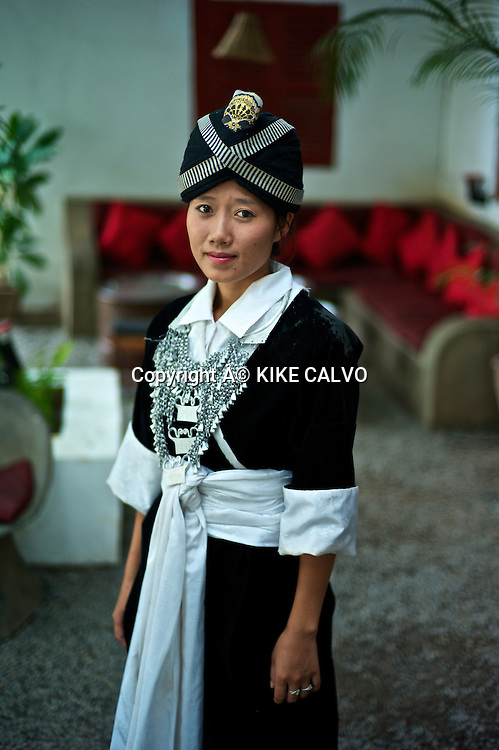 Young girl wearing a Hmong Kao traditional dress in Laos.