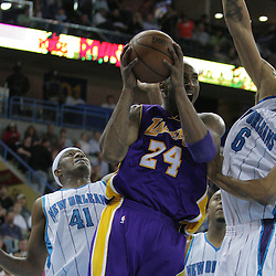 12 November 2008:  Los Angeles Lakers guard Kobe Bryant (24) shoots between Hornets defenders James Posey (41) and Tyson Chandler (6) during a 93-86 win by the Los Angeles Lakers over the New Orleans Hornets at at the New Orleans Arena in New Orleans, LA..