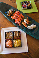 Japanese New Years cuisine is called osechi-ryori, and consists of many different kinds of dishes.  Traditionally, people finish cooking osechi dishes by New Year's Eve so they have food for a couple days without cooking. Most of the dishes can last a few days in the refrigerator or at cool room temperature. Colorful osechi-ryori dishes are packed in layers of lacquer boxes, called jubako.  Each dish and type of food in osechi has meaning, such as good health, fertility, good harvest, happiness, long life...