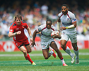 The fastest man in World Rugby Carlin Isles of the USA goes past a Welsh tackle during the Hong Kong Sevens 2015 match between USA  Sevens and Wales Sevens at the Hong Kong Stadium, Hong Kong on 28 March 2015. Photo by Ian Muir....during the Hong Kong Sevens 2015 match between ........... at Hong Kong Stadium, Hong Kong on 27 March 2015. Photo by Ian Muir.