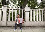 Park Wol-Gwang (82) plays accordion at Tapgol Park in Seoul, South Korea on July 17, 2017. Photo by Lee Jae-Won (SOUTH KOREA) www.leejaewonpix.com
