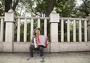 Park Wol-Gwang (82) plays accordion at Tapgol Park in Seoul, South Korea on July 17, 2017. Photo by Lee Jae-Won (SOUTH KOREA) www.leejaewonpix.com