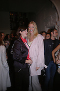 JASMINE GUINNESS AND JODIE KIDD,Launch of Stella McCartney collaboration with H & M. St. Olaves. Tooley St. London SE1. 25 October 2005. October 2005. ONE TIME USE ONLY - DO NOT ARCHIVE © Copyright Photograph by Dafydd Jones 66 Stockwell Park Rd. London SW9 0DA Tel 020 7733 0108 www.dafjones.com