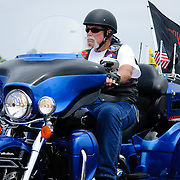 A rider on a large blue trike participating in the annual Rolling Thunder motorcycle rally through downtown Washington DC on May 29, 2011. This shot was taken as the riders were leaving the staging area in the Pentagon's north parking lot, where thousands of bikes and riders had gathered.