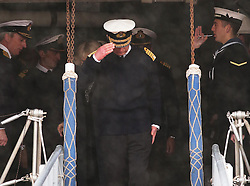 The Prince of Wales salutes as he  leaves HMS Illustrious in Portsmouth, United Kingdom, Wednesday, 26th February 2014. Picture by Stephen Lock / i-Images