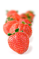 Strawberries on white background - close up