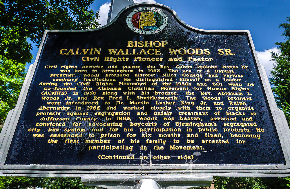 A plaque commemorates the life of civil rights pioneer Rev. Calvin Wallace Woods, Sr., July 12, 2015, at Kelly Ingram Park in Birmingham, Alabama. The four-acre park is located in the Birmingham Civil Rights District and was one of the main staging area for civil rights activists. Woods was beaten, arrested, and convicted for advocating the Birmingham bus boycotts. (Photo by Carmen K. Sisson/Cloudybright)