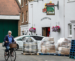 "© Licensed to London News Pictures. 02/07/2020. London, UK. Roll out the Barrels. Workers at Fullers Brewery on the Great West Road, Chiswick load up beer barrels for ""Super Saturday"" as cafes, restaurants, pubs and hairdressers, prepare for the big opening tomorrow after Prime Minister Boris Johnson gave the go ahead in his statement to the Nation last week. Photo credit: Alex Lentati/LNP"