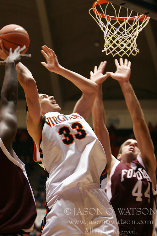 Jason Cain (33) scoring two of his career high 16 points against Fordham.  UVA lost the game 62-60...The Virginia Cavaliers fell to the Fordham Rams 62-60 at University Hall in Charlottesville, VA on December 7, 2005.