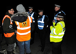 © Licensed to London News Pictures. 10/10/2013.  Gloucestershire, UK.  Police talk with the Wounded Badger Patrol in Gloucestershire, where patrollers go out looking for dead or wounded badgers on public footpaths and roads.  The Government has licensed a pilot badger cull in parts of Somerset and Gloucestershire as part of efforts to reduce bovine tuberculosis in cows on farms and is considering extending the cull as the targets for culled badgers have not been met.  10 October 2013.<br /> Photo credit : Simon Chapman/LNP