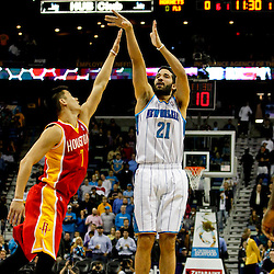 Jan 9, 2013; New Orleans, LA, USA; New Orleans Hornets point guard Greivis Vasquez (21) shoots over Houston Rockets point guard Jeremy Lin (7) during the first quarter of a game at the New Orleans Arena. Mandatory Credit: Derick E. Hingle-USA TODAY Sports