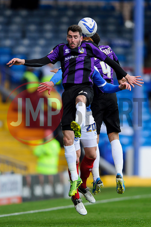 Michael Smith (NIR) of Bristol Rovers and Ryan Taylor (ENG) of Portsmouth compete in the air - Photo mandatory by-line: Rogan Thomson/JMP - 07966 386802 - 19/04/2014 - SPORT - FOOTBALL - Fratton Park, Portsmouth - Portsmouth FC v Bristol Rovers - Sky Bet Football League 2.