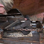 Mallaig Boatyard. Steel plate being fitted to the hull off the Frey.  Picture Robert Perry 9th April 2016<br /> <br /> Must credit photo to Robert Perry<br /> FEE PAYABLE FOR REPRO USE<br /> FEE PAYABLE FOR ALL INTERNET USE<br /> www.robertperry.co.uk<br /> NB -This image is not to be distributed without the prior consent of the copyright holder.<br /> in using this image you agree to abide by terms and conditions as stated in this caption.<br /> All monies payable to Robert Perry<br /> <br /> (PLEASE DO NOT REMOVE THIS CAPTION)<br /> This image is intended for Editorial use (e.g. news). Any commercial or promotional use requires additional clearance. <br /> Copyright 2014 All rights protected.<br /> first use only<br /> contact details<br /> Robert Perry     <br /> 07702 631 477<br /> robertperryphotos@gmail.com<br /> no internet usage without prior consent.         <br /> Robert Perry reserves the right to pursue unauthorised use of this image . If you violate my intellectual property you may be liable for  damages, loss of income, and profits you derive from the use of this image.