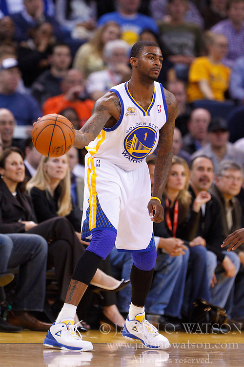 Feb 2, 2012; Oakland, CA, USA; Golden State Warriors small forward Dorell Wright (1) dribbles the ball against the Utah Jazz during the third quarter at Oracle Arena. Golden State defeated Utah 119-101. Mandatory Credit: Jason O. Watson-US PRESSWIRE