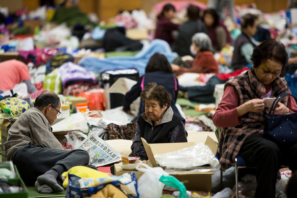 KUMAMOTO, JAPAN - APRIL 21:  A family, survived from earthquake take rest  in the morning on April 20, 2016 in Mashiki Gymnasium evacuation center, Kumamoto, Japan. To date 45 people are confirmed dead and around 11,000 people have evacuated after an 6.5 earthquake on Thursday night and a stronger 7.3 quake on Saturday morning struck the Kyushu Island in western Japan.<br /> <br /> Photo: Richard Atrero de Guzman