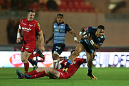 Willis Halaholo of Cardiff Blues &reg; is stopped by Rhys Patchell of the Scarlets (on ground). . Guinness Pro14 rugby match, Scarlets v Cardiff Blues  at the Parc y Scarlets in Llanelli, West Wales on Saturday 28th October 2017.<br /> pic by  Andrew Orchard, Andrew Orchard sports photography.