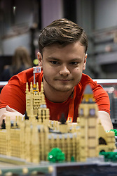 The SEC in Glasgow hosts Brick Live, the largest LEGO exhibition in the UK. Featuring models made up of over 6 million bricks, LEGO enthusiasts can build their own creations as well as admiring the models created by some of the leading designers including Scotland's Nick Clayton and Rocco Buttliere from Chicago.<br /> <br /> Pictured: Rocco Buttliere and his LEGO model of the Palace of Westminster and Westminster Abbey made from over 14,000 bricks