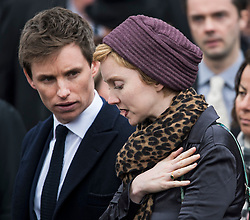 © Licensed to London News Pictures. 31/03/2018. Cambridge, UK. Actor EDDIE REDMAYNE(L) and Model and actress LILY COLE (R) leave The funeral of Stephen Hawking at Church of St Mary the Great in Cambridge, Cambridgeshire. Professor Hawking, who was famous for ground-breaking work on singularities and black hole mechanics, suffered from motor neurone disease from the age of 21. He died at his Cambridge home in the morning of 14 March 2018, at the age of 76. Photo credit: Ben Cawthra/LNP