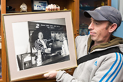 Wayne Bolley, nephew of the late Joyce Rose, a former tea lady at at the BBC who gave bosses the idea for Children In Need, with a picture of his aunt dressed as a Pearly Queen at a fundraiser. London, November 14 2018.