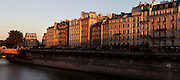 General view of Quai Saint Michel, 19th century, Paris, France, at sunset. The Quai stretches along the Left Bank of the River Seine, meeting the Boulevard Saint Michel by the Pont Michel, visible to the left of the image. The buildings are typical of the Haussmann reconstruction of Paris. Picture  by Manuel Cohen.