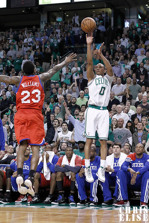 14 May 2012: Boston Celtics shooting guard Avery Bradley (0) takes a jumpshot over Philadelphia Sixers point guard Lou Williams (23) during the Philadelphia Sixers 82-81 victory over the Boston Celtics, in Game 2 of the Eastern Conference semifinals playoff series, at the TD Banknorth Garden, Boston, Massachusetts, USA.