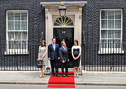 LONDON UK British Prime Minister David Cameron and his wife Samantha greet French President Nicolas Sarkozy and his wife Carla Bruni-Sarkozy on the steps of 10 Downing Street in central London. Sarkozy and World War II veterans visited London to mark the 70th anniversary of Charles de Gaulle's radio appeal to resist the Nazi occupation.  June 18 2010, STEPHEN SIMPSON