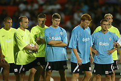 BANGKOK, THAILAND - Wednesday, July 23, 2003: Liverpool players (l-r) Milan Baros, Danny Murphy, Anthony Le Tallec, Steven Gerrard, John Arne Riise, Michael Owen and Stephane Henchoz during a training session in at the Rajamangala National Stadium. (Pic by David Rawcliffe/Propaganda)