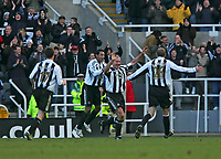 Photo: Andrew Unwin.<br />Newcastle United v Bolton Wanderers. The Barclays Premiership. 04/03/2006.<br />Newcastle's Alan Shearer (R of C) celebrates scoring his team's second goal.
