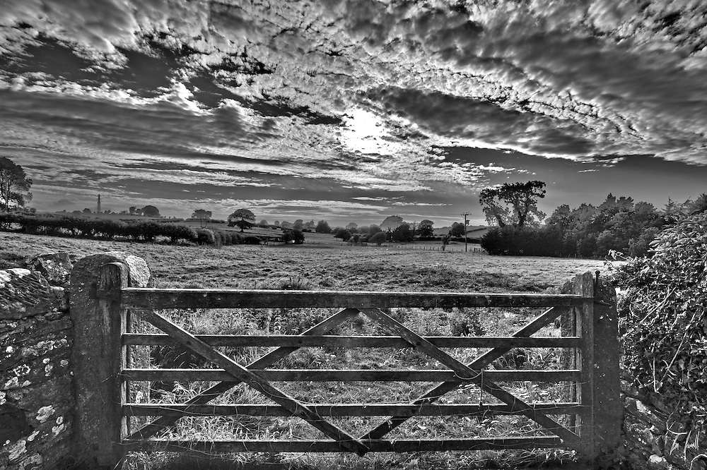 Black and white image of the front entrance to a field behind a Georgian farmhouse in the Lake District.