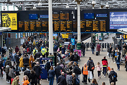 Busy passenger concourse at Waverley Station iN Edinburgh, Scotland, UK