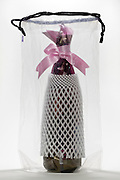 pink bow gift wrapped bottle with transport protection foam in transparent bag