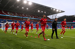 Wales players warm up prior to the League B, Group four match at Cardiff City Stadium.