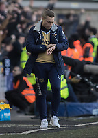 Football - 2016 / 2017 FA Cup - Fifth Round: Millwall vs. Leicester City <br /> <br /> Millwall Manager Neil Harris checks his watch at The Den<br /> <br /> COLORSPORT/DANIEL BEARHAM