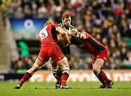Picture by Andrew Tobin/Focus Images Ltd. 07710 761829. .27/12/11. Chris Robshaw (7) of Harlequins is tackled by George Kruis (5) of Saracens (L) during the Aviva Premiership match between Harlequins and Saracens at Twickenham Stadium, London.