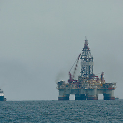 Seadrill (SDRL) a ultra-deepwater semi-submersible rig West Sirius assigned by Devon Energy (DVN) and Seadrill (SDRL) to operate for BP (BP Plc) is seen near the source of the BP Plc Deep Water Horizon oil spill site in the Gulf of Mexico off the coast of Louisiana, U.S., on Thursday, July 15, 2010. Photographer: Derick E. Hingle/Bloomberg